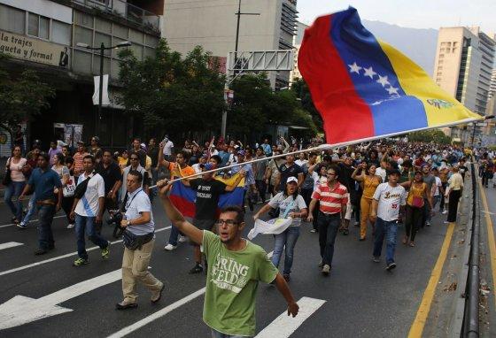 """""""Reuters""""/""""Scanpix"""" nuotr./Protestuotojai Venesueloje"""