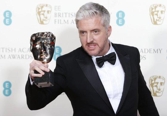 """""""Reuters""""/""""Scanpix"""" nuotr./Anthony McCartenas apdovanotas už geriausią adaptuotą scenarijų filmui """"Visko teorija"""""""