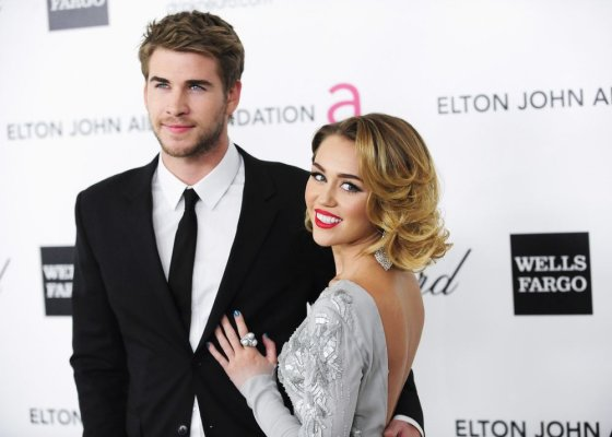 """Reuters""/""Scanpix"" nuotr./Miley Cyrus ir Liamas Hemsworthas"