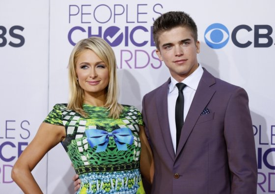"""Reuters""/""Scanpix"" nuotr./Paris Hilton ir Riveris Viiperi"