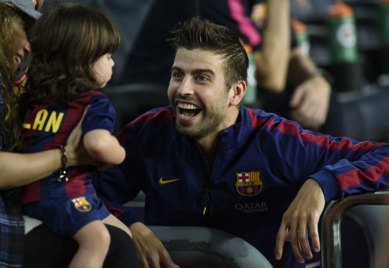 "AFP/""Scanpix"" nuotr./Gerardas Pique su sūnumi Milanu"