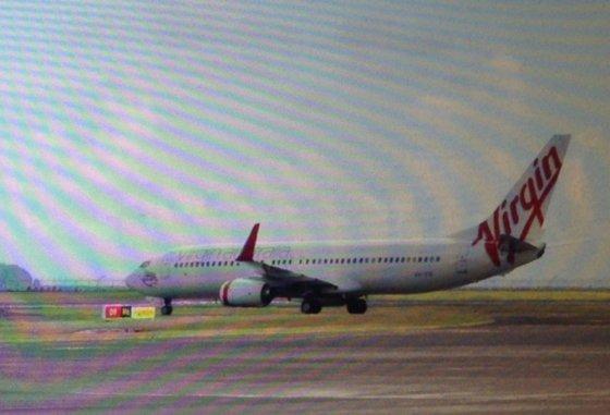 """AFP/""""Scanpix"""" nuotr./Virgin Australia lėktuvas nutupdytas Balio oro uoste išsigandus užgrobimo pavojaus"""