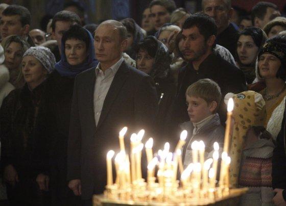 """""""Scanpix"""" nuotr./Vladimiras Putinas dalyvauja Kalėdų mišiose Sočyje"""