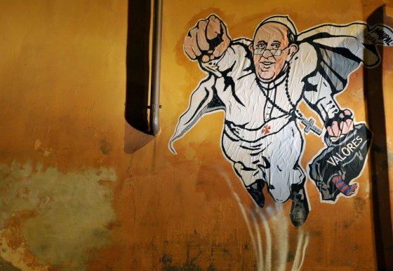 """AFP/""""Scanpix"""" nuotr./Ant sienos nupiešas Popiežius Pranciškus"""