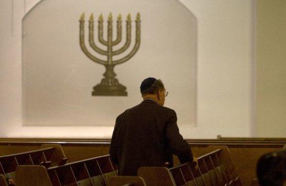 """""""Reuters""""/""""Scanpix"""" nuotr./Žydų bendruomenės narys"""