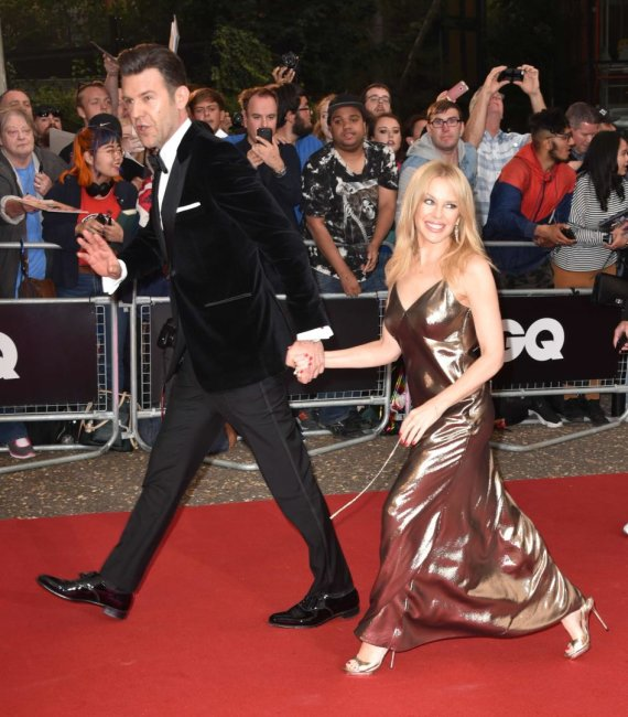 """Scanpix"" nuotr./Kylie Minogue ir Paulas Solomonsas"