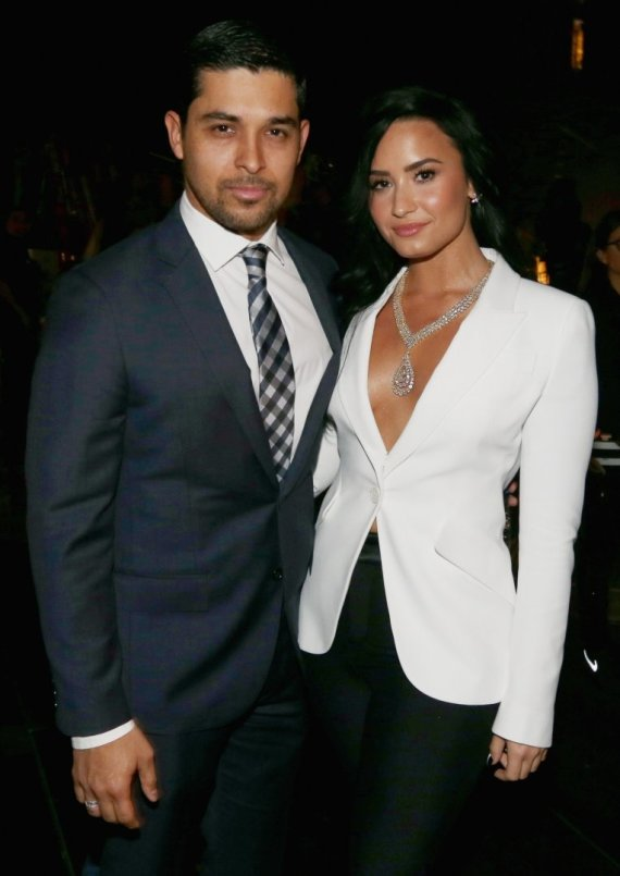"AFP/""Scanpix"" nuotr./Wilmeris Valderrama ir Demi Lovato"