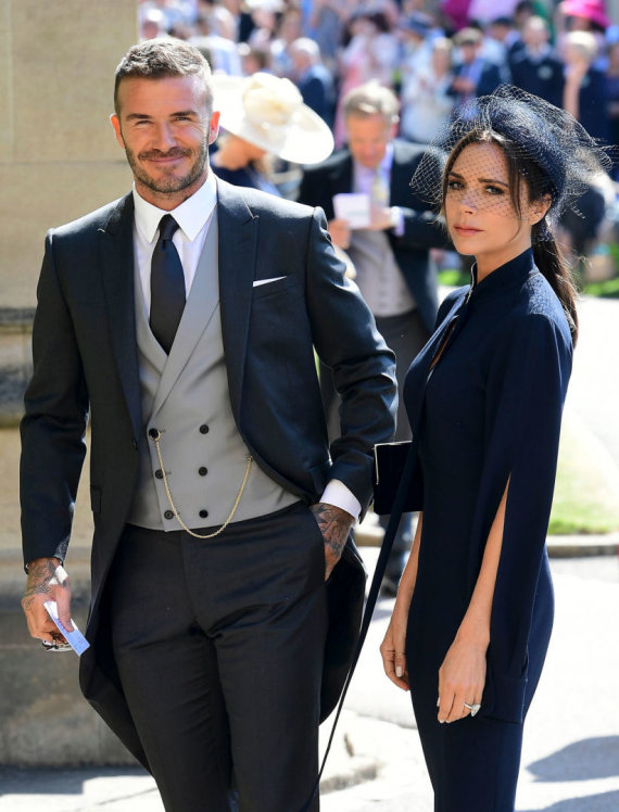 "AFP/""Scanpix"" nuotr./Victoria Beckham ir Davidas Beckhamas per karališkąsias vestuves gegužę"