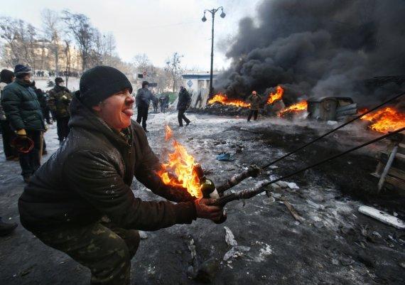 """""""Scanpix""""/AP nuotr./Maidano barikadų sargai"""