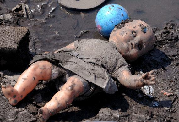 """AFP/""""Scanpix"""" nuotr./Sutepta lėlė"""
