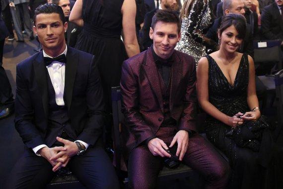 "AFP/""Scanpix"" nuotr./Cristiano Ronaldo, Lionelis Messi ir Antonella Roccuzzo"