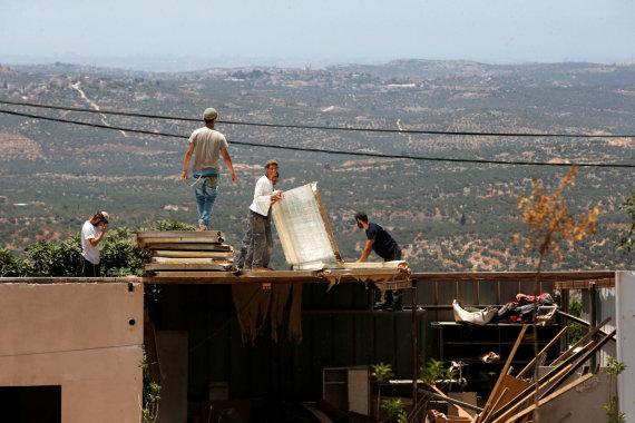 """""""Reuters""""/""""Scanpix"""" nuotr./Vakarų Krante gyvenantys žydai"""