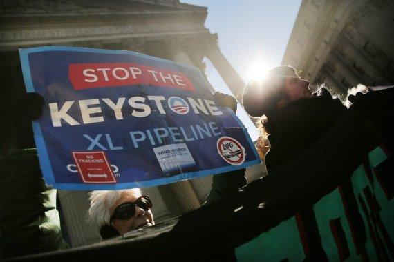 """AFP/""""Scanpix"""" nuotr./Protestas prieš naftotiekio """"Keystone XL"""" tiesimą"""