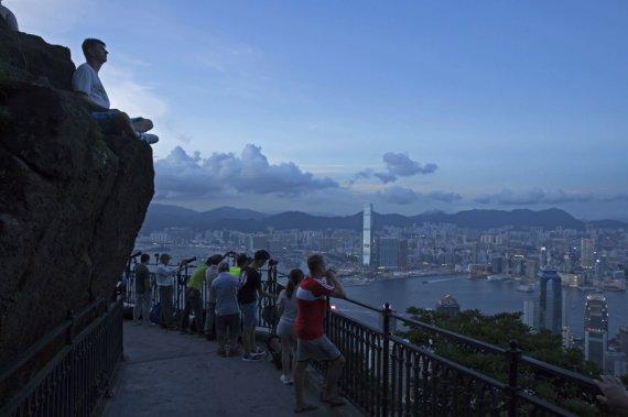 """""""Scanpix""""/AP nuotr./Pakeliui į Viktorijos viršūnę Honkonge"""