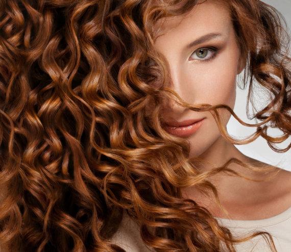 123RF.com nuotr./Garbanoti plaukai