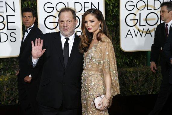 """Reuters""/""Scanpix"" nuotr./Harvey Weinsteinas su žmona Georgina Chapman"