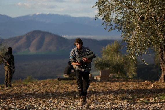 """""""Reuters""""/""""Scanpix"""" nuotr./Laisvosios Sirijos armijos karys Afrine"""