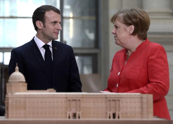 """""""Reuters""""/""""Scanpix"""" nuotr./Emmanuelis Macronas Berlyne su Angela Merkel"""