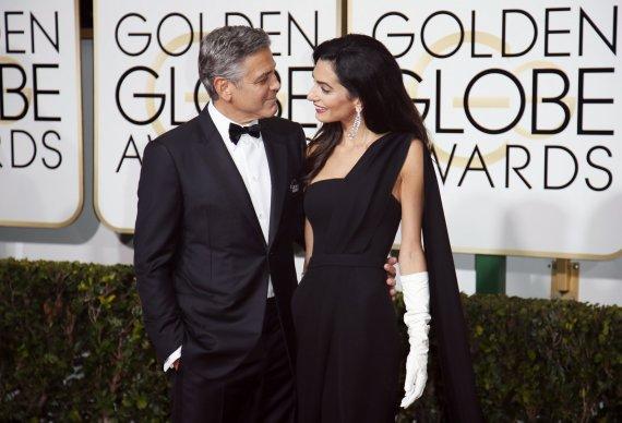 """Reuters""/""Scanpix"" nuotr./George'as Clooney su žmona Amal Clooney"