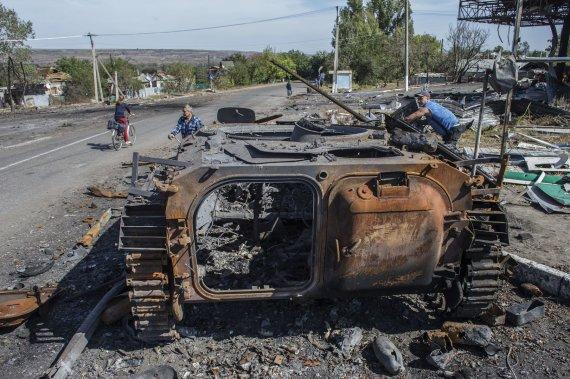 """Reuters""/""Scanpix"" nuotr./Luhanske sudegusi Ukrainos karinė technika"