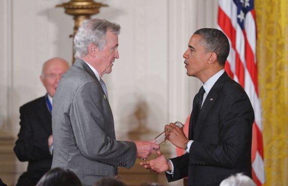 """AFP/""""Scanpix"""" nuotr./A.D.Rotfeldas su Barcku Obama"""