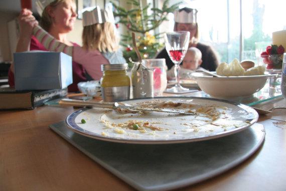 Vida Press nuotr./Tuščia lėkštė ant šventinio stalo