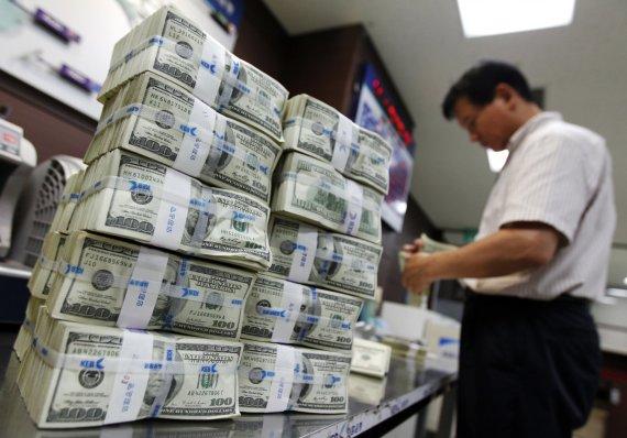 """Reuters""/""Scanpix"" nuotr./JAV doleriai"