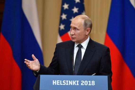 """AFP/""""Scanpix"""" nuotr./Donaldo Trumpo ir Vladimiro Putino susitikimas Helsinkyje"""