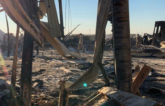 """AFP/""""Scanpix"""" nuotr./Al Asado karinė bazė Irake po Irano raketų atakos"""