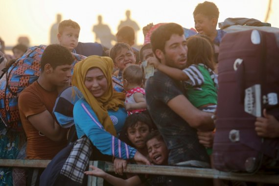 """""""Reuters""""/""""Scanpix"""" nuotr./Pabėgeliai iš Ramadžio miesto Irake"""