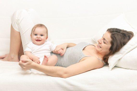 123RF.com nuotr./Mama su kūdikiu.