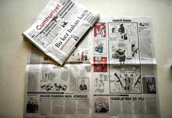 """AFP/""""Scanpix"""" nuotr./Cumhuriyet karikatūros"""