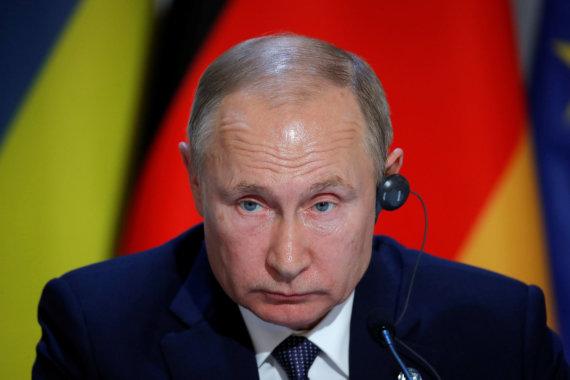 """""""Reuters""""/""""Scanpix"""" nuotr./V.Putinas Paryžiuje"""