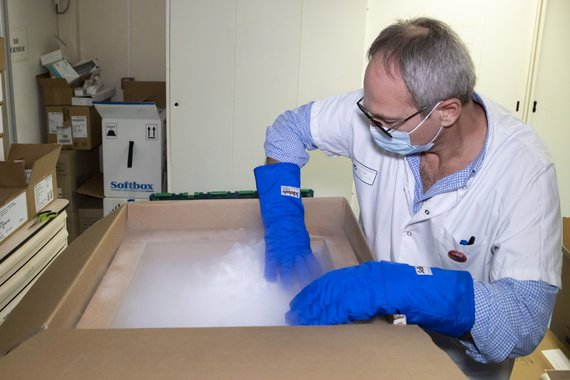 Reuters / Photo by Scanpix / Vaccine bottles pulled out of special freezer