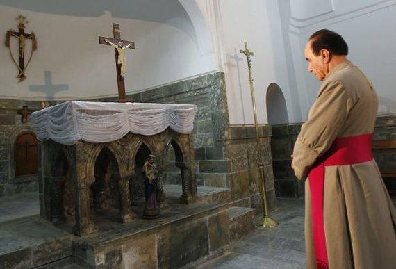 """Reuters""/""Scanpix"" nuotr./Irako krikščionių kunigas Karakušo mieste"