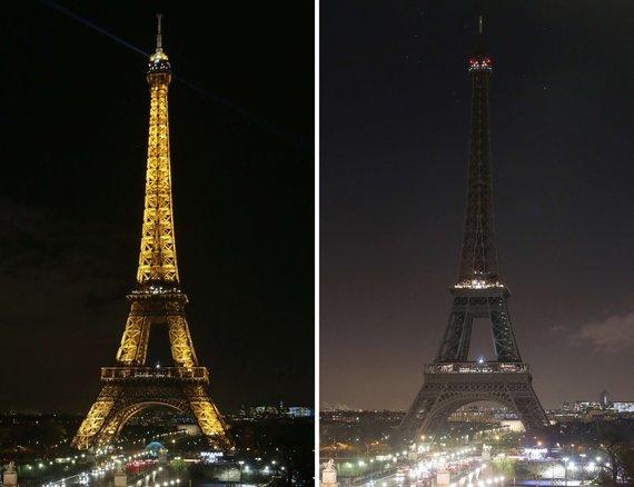 """""""Scanpix""""/ AFP nuotr./Apšviestas Eifelis ir paskendęs tamsoje"""