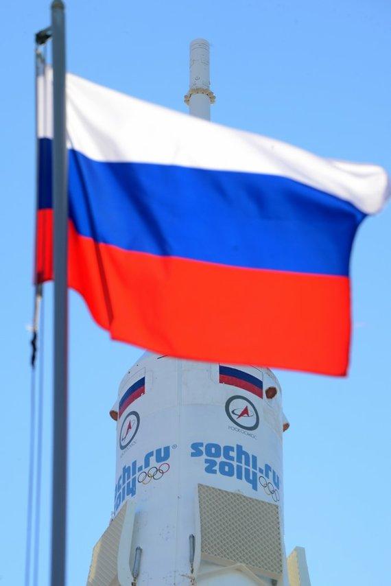 "AFP/""Scanpix"" nuotr./""Sojuz FG"" raketa Rusijos vėliavos fone"