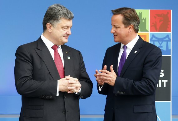 """Reuters""/""Scanpix"" nuotr./Petro Porošenko ir Davidas Cameronas"