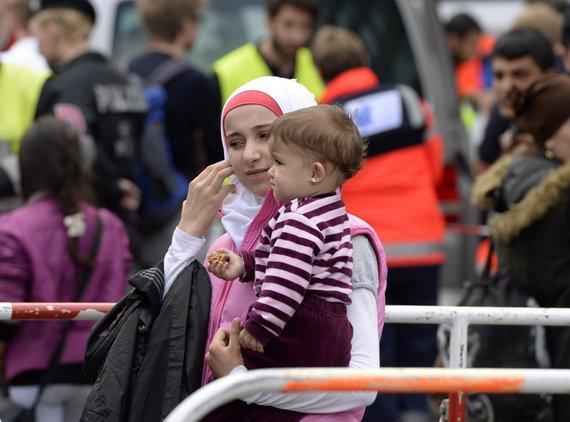 """AFP/""""Scanpix"""" nuotr./Papėgėliai plūsta į Vokietiją"""