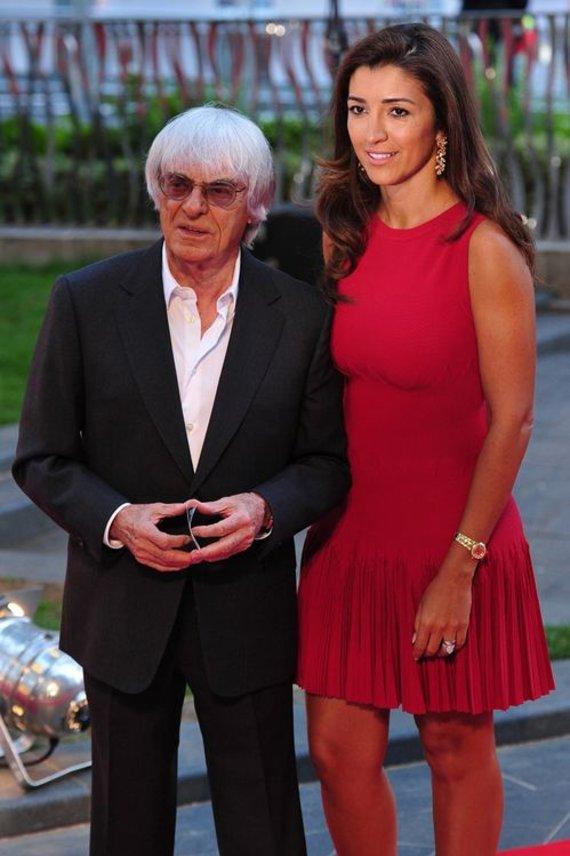 "AFP/""Scanpix"" nuotr./Bernie Ecclestone'as su žmona Fabiana Flosi"