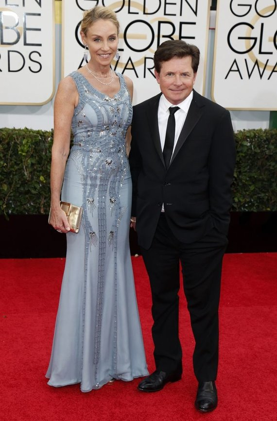 """Reuters""/""Scanpix"" nuotr./Michaelas J.Foxas su žmona Tracy Pollan"