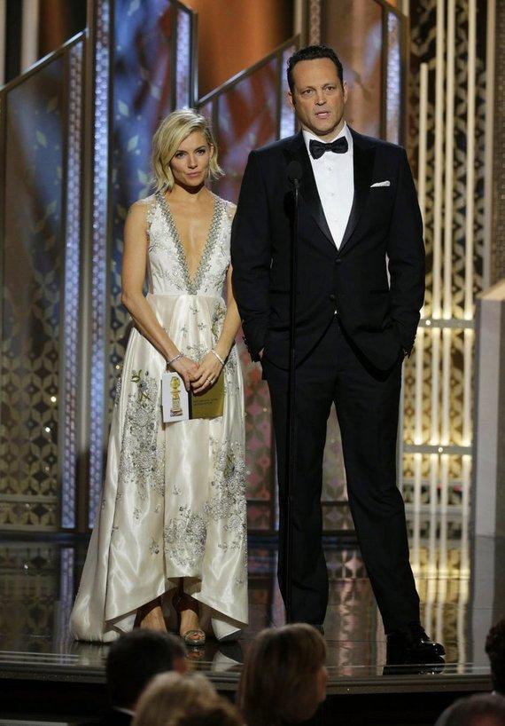 """""""Scanpix""""/AP nuotr./Sienna Miller ir Vince'as Vaughnas"""