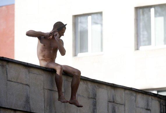 """Reuters""/""Scanpix"" nuotr./Piotro Pavlenskio akcija Maskvoje"