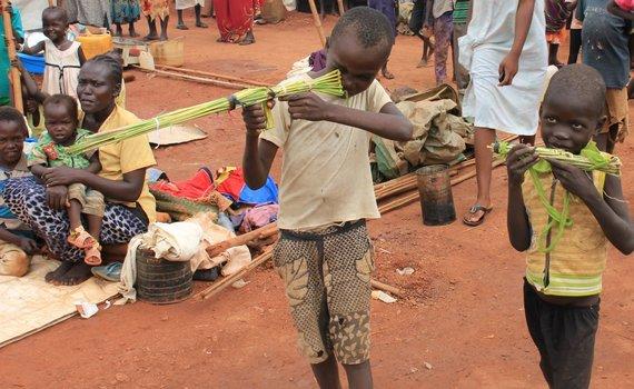 """""""Reuters""""/""""Scanpix"""" nuotr./Žaidžiantys vaikai Pietų Sudane"""