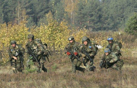 """""""Reuters""""/""""Scanpix"""" nuotr./Latvijos kariai"""