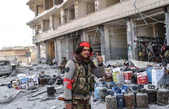 """AFP/""""Scanpix"""" nuotr./Turkija tvirtina """"nepasiliksianti"""" Sirijos Afrino mieste"""