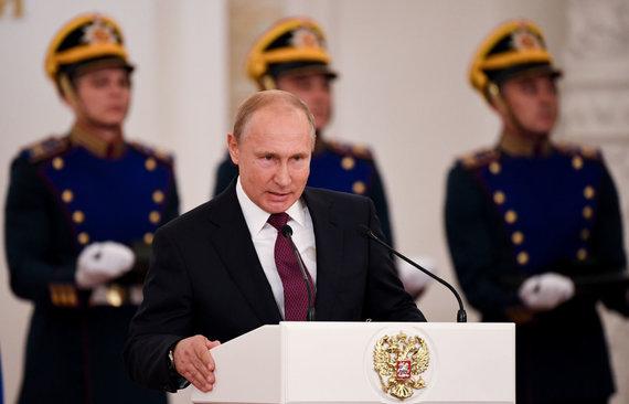 """""""Reuters""""/""""Scanpix"""" nuotr./Vladimiras Putinas sunkiai suvaldo įsismarkavusį elitą"""