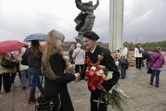 """""""Reuters""""/""""Scanpix"""" nuotr./Pergalės dienos minėjimas Rygoje"""