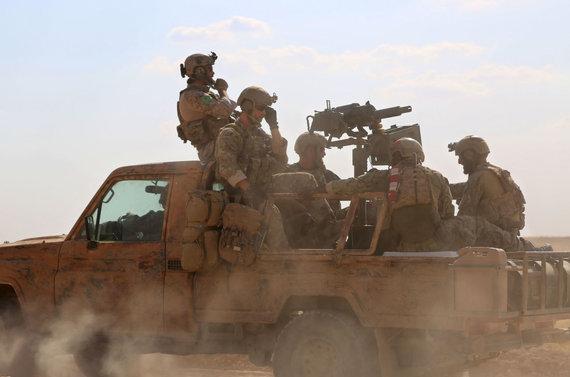 """AFP/""""Scanpix"""" nuotr./JAV specialiųjų pajėgų kariai Sirijoje"""