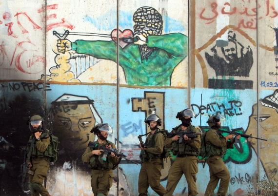 "AFP/""Scanpix"" nuotr./Izraelį ir Palestiną skirianti siena"